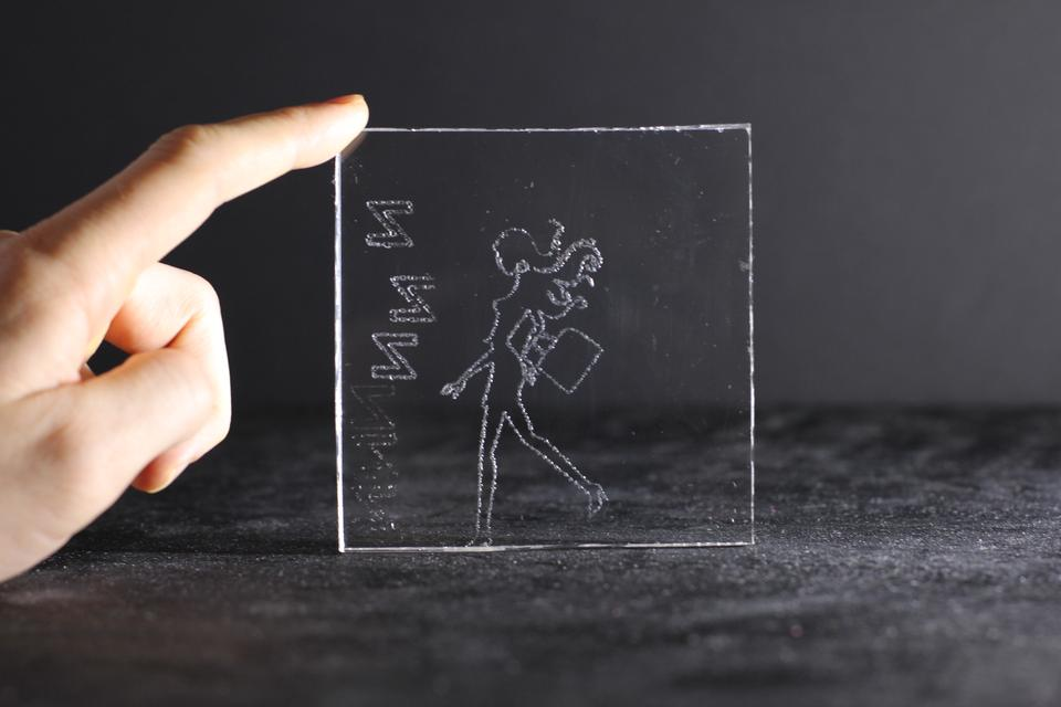A girl laser engraved on acrylic