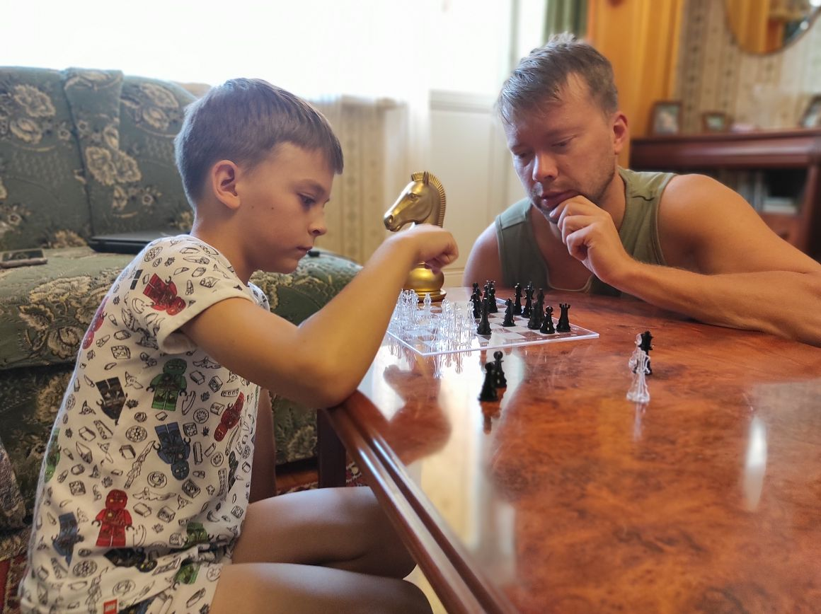 Playing chess: George and Leon