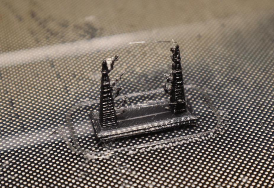 A test print displaying stringing that occured as the hotend traveled from pillar to pillar.