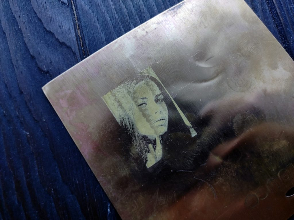 photo engraving on brass