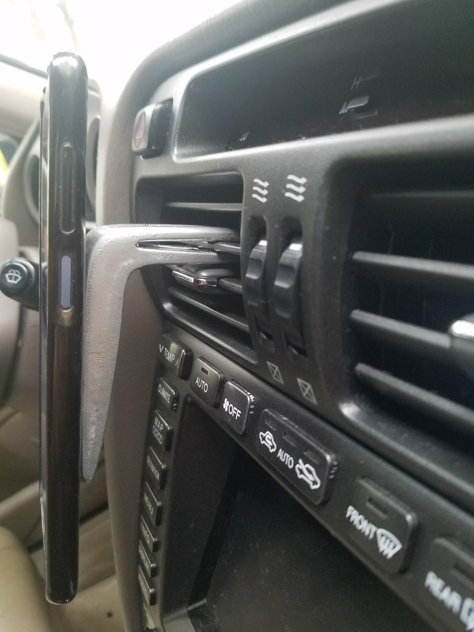 A DIY plywood smartphone holder for your car